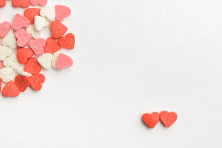 paper heart: Two hearts found each other in crowd Stock Photo