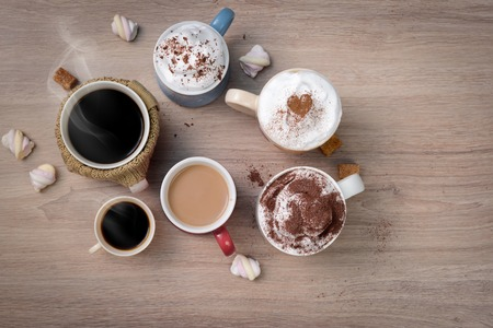 finds: Cups of different kinds of coffee drinks as family or friendly company symbol. Everybody finds his own kind of coffee. Stock Photo