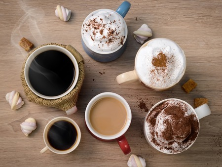 Cups of different kinds of coffee drinks as family or friendly company symbol. Everybody finds his own kind of coffee. 写真素材