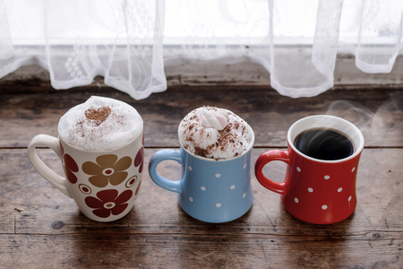 Cups Of Different Kinds Of Coffee Drinks As Family Or Friendly