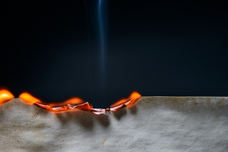 Burning edge of paper on dark background Stock Photo - 51354630