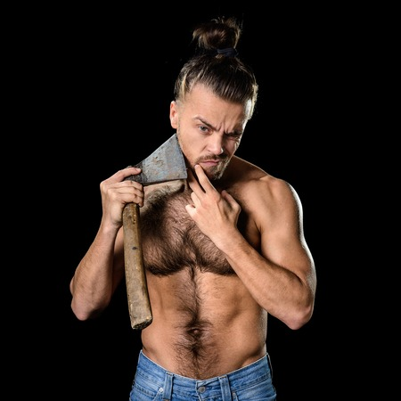 dull: Brutal young man shaving himself with rusty dull axe Stock Photo