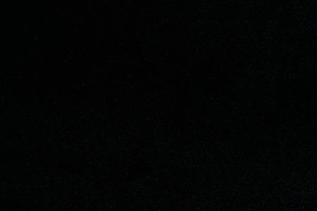 小さな光ると黒のシルク ベルベット背景にフルサイズで宇宙の星のように見える