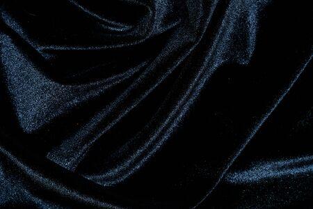 shiny black: Black silk velvet background with shiny folds