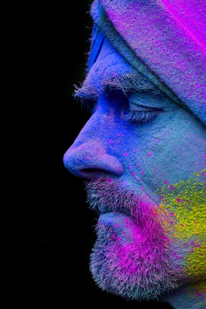 Senior man in traditional Indian turban fully covered with paint holi 写真素材