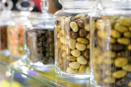 descriptive colour: Candies in glass jars in candy shop