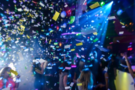 Colorful confetti falling to a crowded nightclub Reklamní fotografie