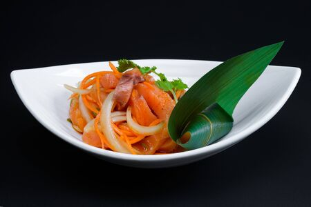 korean salad: Korean salad in a deep plate on dark background