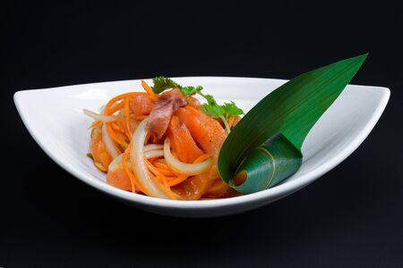 korean salad: Korean salad in a deep plate on dark background