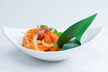 korean salad: Korean salad in a deep plate on light background