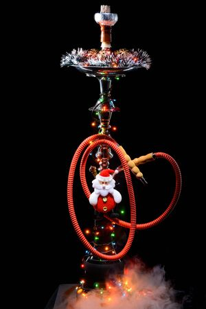 christmas toy: Smoking hookah with New Years decorations on dark background