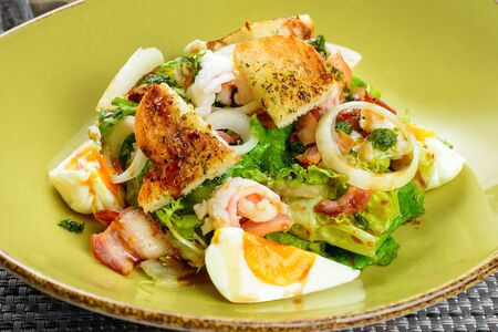 egg roll: Korean salad with egg and seafood in green dish