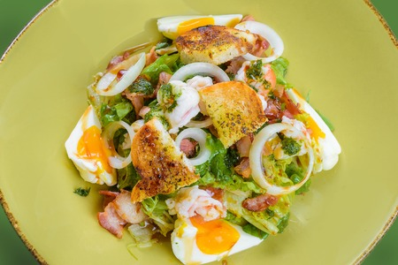sop: Korean salad with egg and seafood in green dish