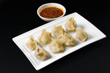 Fried dumplings with sauce in Korean style Stock Photo