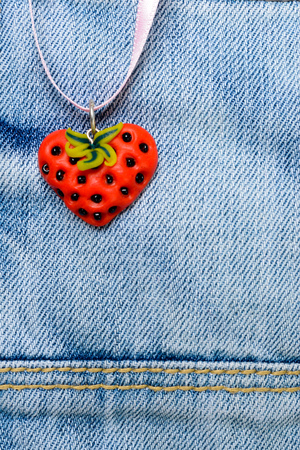 Strawberry heart on jeans 写真素材