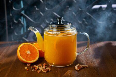 Teapot of hot citrus tea Stock Photo