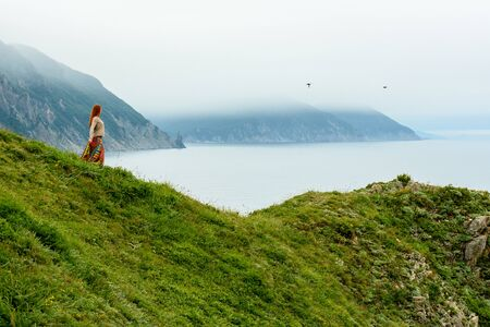 Long-haired girl on sea shore