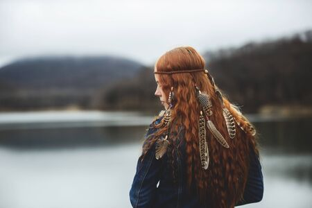 Long-haired girl on lake shore Stock Photo