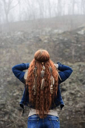 Long-haired girl in forest
