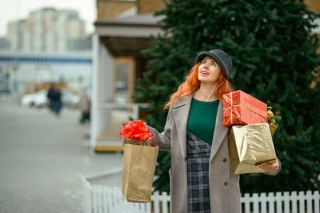 Woman goes shopping for gifts Stock Photo