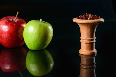 Apple tobacco for hookah Stock Photo