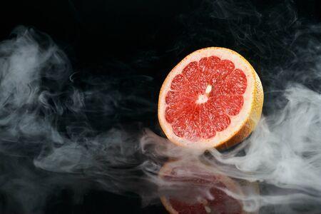 Grapefruit in fragrant smoke