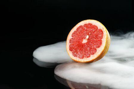 Ice cold grapefruit in fragrant smoke