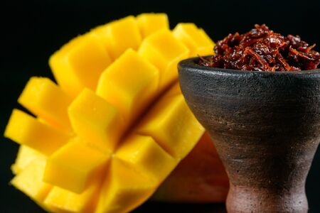 Exotic tobacco with mango Stock Photo - 137755052