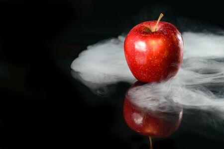 Apple in fragrant smoke Stock Photo