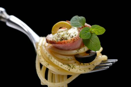 Spaghetti with bacon on fork 写真素材