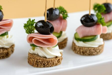 Canape with bacon and olive