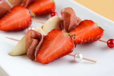 Canape with prosciutto and strawberries