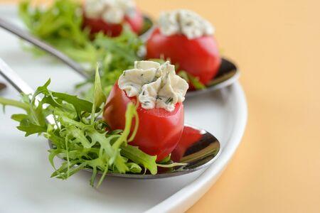 Stuffed tomatoes with arugula