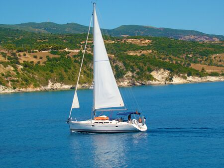 A sailing boat in the ionian sea       photo