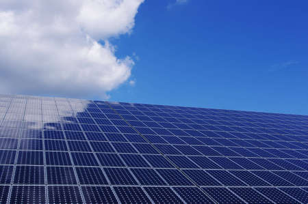 energy supply: Solar panel and blue sky. Renewable, clean energy.