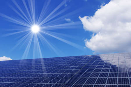 Clean energy generating solar panel and sun. photo