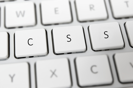 CSS Cascading Style Sheets on white keyboard Stock Photo - 27584136