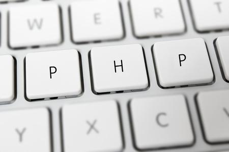 server side: PHP server side script language on white keyboard Stock Photo