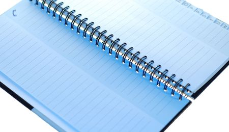A small spiral notebook being opened ready for use Stock Photo - 2247874