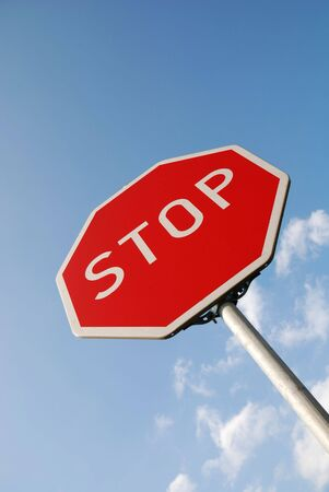 roadside stand: Stop traffic sign against blue sky