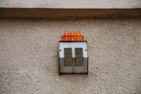 alarm light and siren hanging on wall. photo