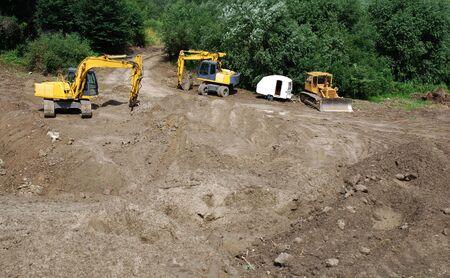 excavate:  excavator digging ground