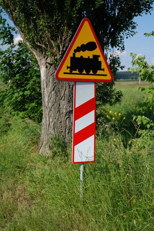 Road sign - danger, train photo