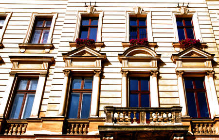 partment: Old urban house in Krakow, wall and window, Poland