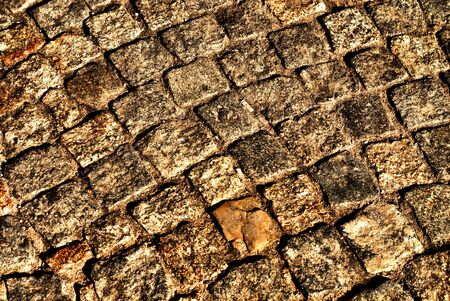 Old gray medieval weathered cobblestone way photo