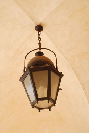 Old decoration lantern on a stones wall photo