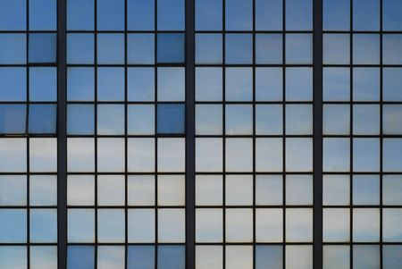 Fragment of the skyscraper over sky background  photo