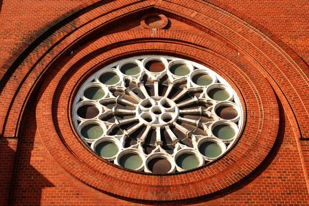 rose window: Little window of the ancient prison brick wall  Stock Photo