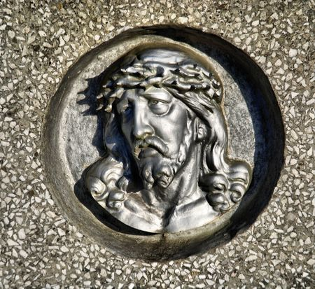 face of Jesus, old statue in cemetery  photo