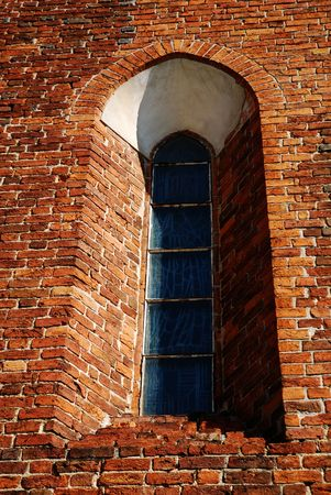 ancient prison: Little window of the ancient prison brick wall  Stock Photo